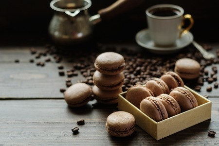 Chocolate cocoa French biscuits macarons with coffee Stock Photo
