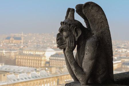 Paris, France - March 17, 2015: Strix or stryge sculpture on Notre Dame de Paris facade