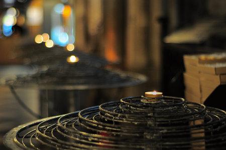 Paris, France - November 7, 2013: Candles in Notre Dame de Paris