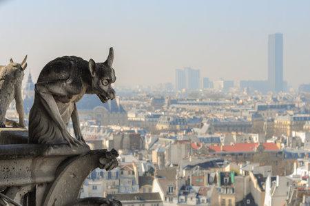 Paris, France - March 17, 2015: Chimera sculpture on Notre Dame de Paris facade