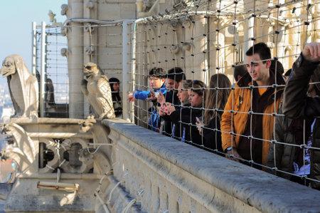 Paris, France - March 17, 2015: People at view point of Notre Dame de Parisnear chimeras