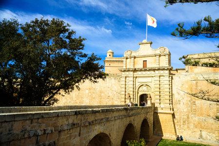 Mdina, Malta - February 15, 2019: Gates of ancient Mdina, Malta. Sunny day, blue sky with clouds Editorial
