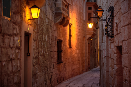 Mdina, Malta - February 19 2019: Ancient street of Mdina, Malta at night. Editorial