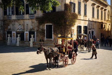 Mdina, Malta - February 15, 2019: Traditional horse carriage on Bastion square Editorial