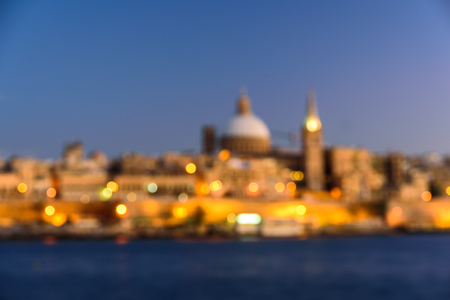 Classic postcard view to Basilica of Our Lady of Mount Carmel and St Pauls Pro-Cathedral. Valletta, Malta. Clear sky, sunset. Blurred Imagens