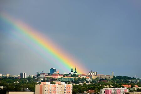 Big rainbow over Tallinn, Estonia. Moment just after rain. Panoramic view to Old Town Reklamní fotografie