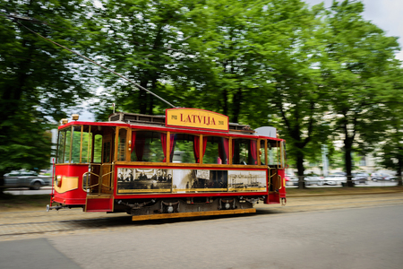 Riga, Latvia - May 25, 2019: Old historical tram on street of Riga. In motion, selective focus Redakční
