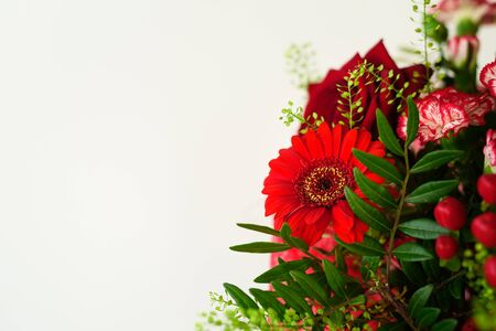 Beautiful red flower bouquet with roses on grey background