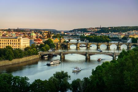 View to Prague bridges on Vltava from view point Letensky profil at sunset