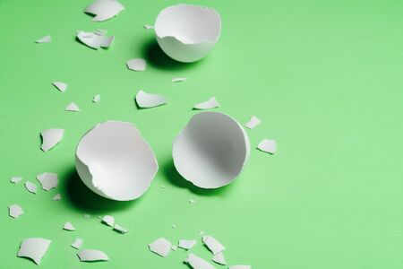 Cracked egg on neo mint trendy background. Text space
