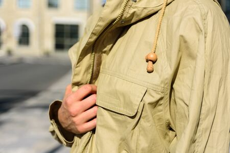 Close up of woman in beige oversize coat. Street style Stock Photo