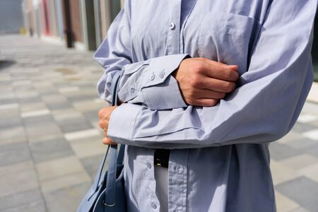 Close up of woman in man oversize shirt. Street style