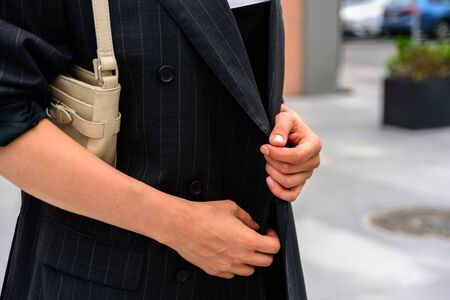 Close up of woman in black oversize blazer. Street style Stock Photo