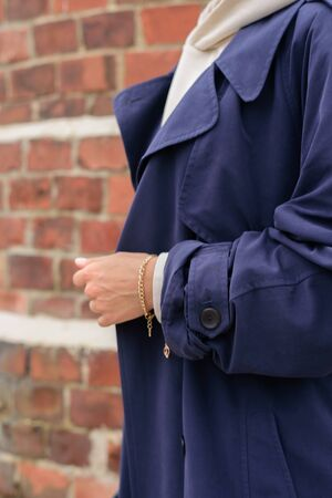 Close up of woman in blue oversize coat. Street style Stock Photo