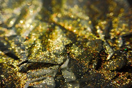 Black paper and golden glitter texture. New year, christmas and sale abstract background Stock Photo