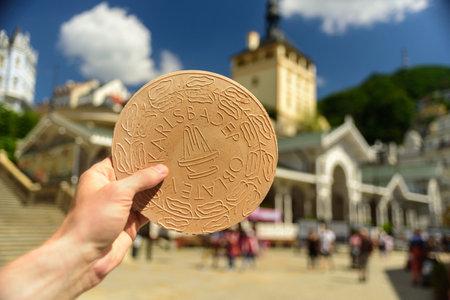 Karlovy Vary, Czech - July 2 2019: Hand with traditional spa waffle of Karlovy Vary - Karlsbad Oblaten, oplatky Redakční