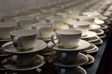 Many empty cups for coffee in restaurant or hotel