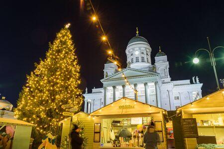 HELSINKI, FINLAND - December 10, 2019: Christmas market on Senate Square. Cathedral, tree at night