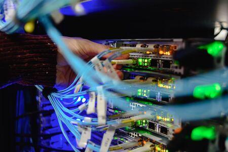 Man data center technician performing server maintenance. Replacing cables, Stock fotó
