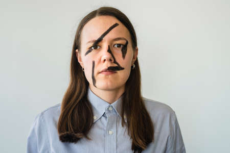 Woman with hiding face makeup against facial recognition