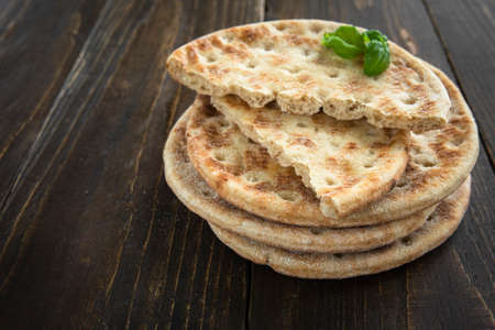 Stack of soft flatbread on wooden table Standard-Bild - 151206539