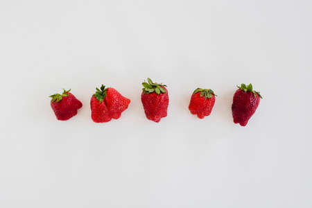 Ugly strawberry fruits. Reduce food waste concept