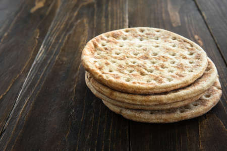 Stack of soft flatbread on wooden table 免版税图像