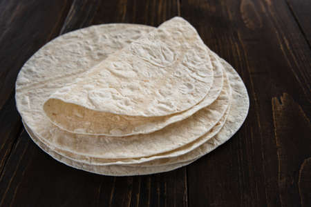 Lavash thin unleavened Armenian flatbread on wooden table