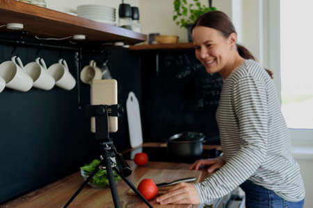 Woman cooking and online video streaming. Vlogger, food blogger