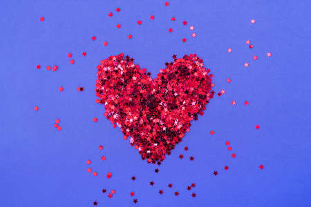 Heart shaped red sparkles on purple background. Love, Valentines day