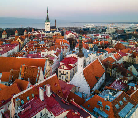 Tallinn, Estonia - December 9, 2020: Aerial view to Medieval Old Town with red roofs, church and streets