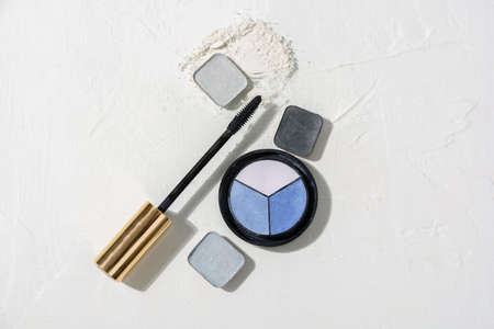 Composition of decorative cosmetic smears or swatches - eye shadows different colors, mascara