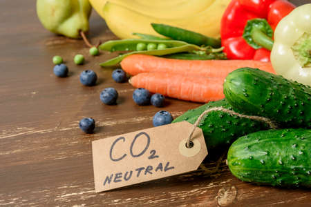 Local organic vegetables and fruits with carbon emission label made from recycled paper