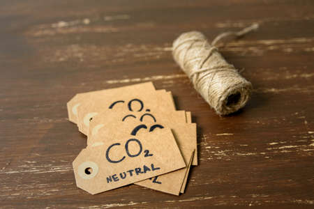 Carbon emission label concept. Made from recycled paper