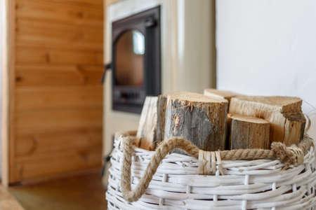 Basket with firewood near country furnace in Estonia Hiiumaa