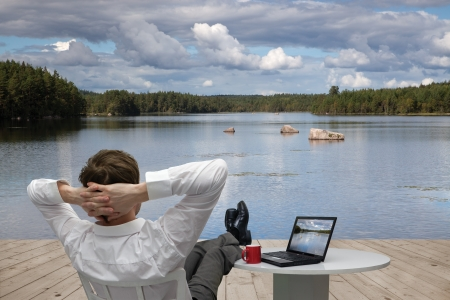 relaxes: Hombre de negocios que se relaja Foto de archivo