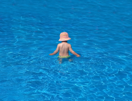 felicity: Small baby in swimming pool on holiday