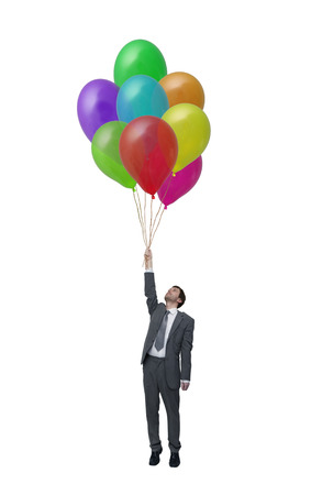 impasse: Picture businessman with many balloons in hand