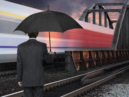 man with umbrella and speed train Stock Photo - 23423263