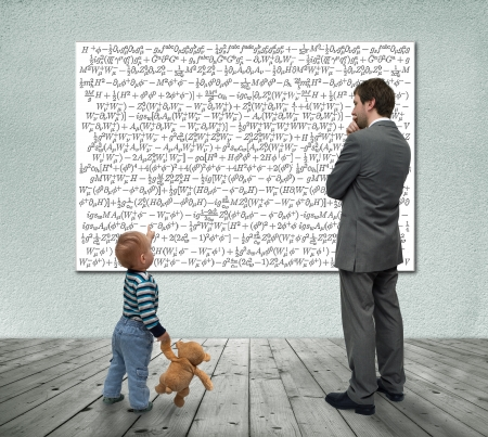 Small boy with businessman looking at board with mathematic formulas  Stock Photo