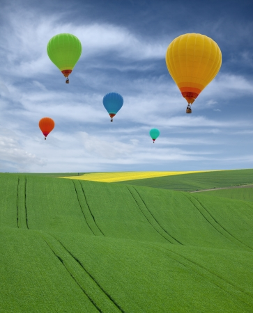 five balloons over a landscape Stock Photo