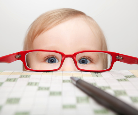 Little boy looking through glasses