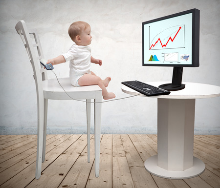 small child and a computer Stock Photo