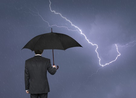 upstream: man with an umbrella in a storm