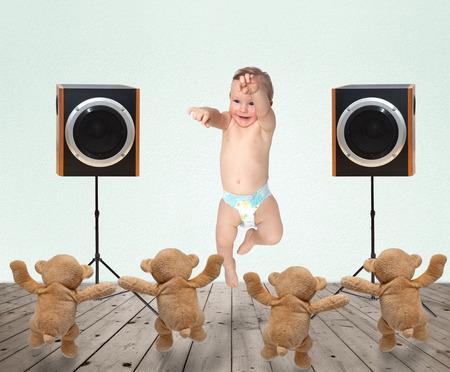 felicity: little boy dancing with teddy bears Stock Photo