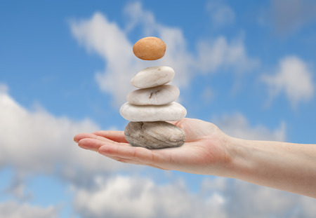 certainty: hand balancing with multiple stones Stock Photo
