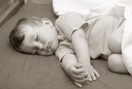 felicity: Portrait of a little boy sleeping in bed Stock Photo