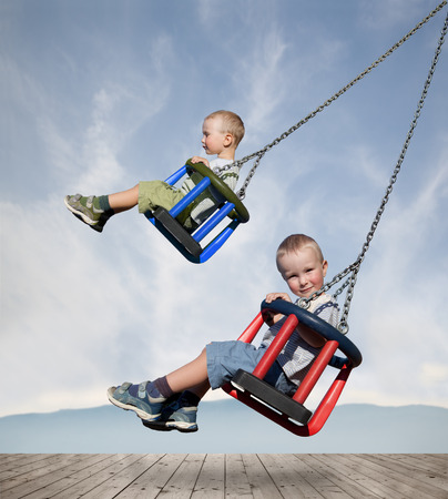 felicity: two boys are swinging on a swing
