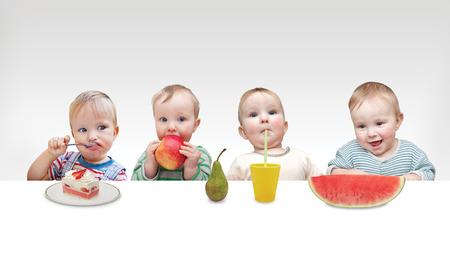 felicity: four little boyss having fruit Stock Photo
