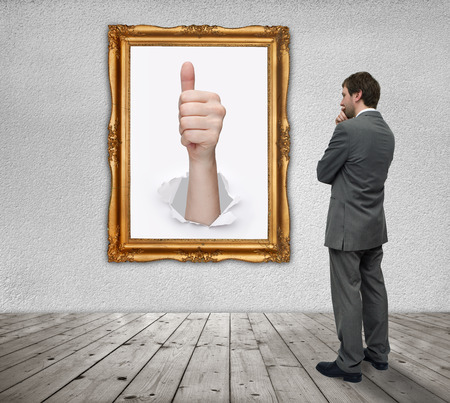 gesture of success in a gold frame and businessman photo